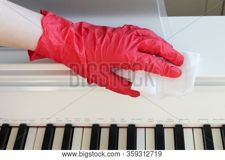 Coronavirus Covid-19 Sanitize Disinfecting Wipes Cleaning Disinfection Of Musical Instrument. Wiping