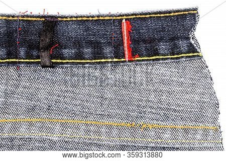 Piece Of Black Jeans Fabric Isolated On White Background. Rough Uneven Edges. Denim Jeans Torn. Back