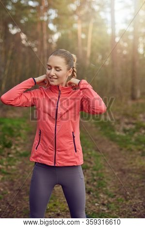 Fit Healthy Slender Happy Young Woman Outdoors At Sunset Walking Along A Forest Trail Backlit By The