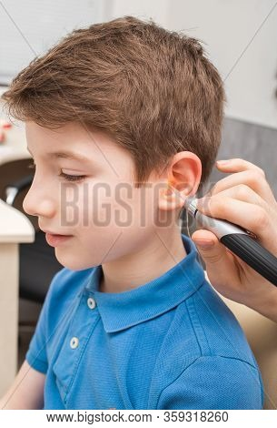 Process Of Making A Custom Earplug For A Child. Stages Of Manufacturing Earplugs. Audiologist Makes