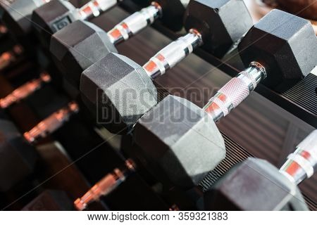 Dumbbells In A Rack At The Gym. Free Weights Closeup.