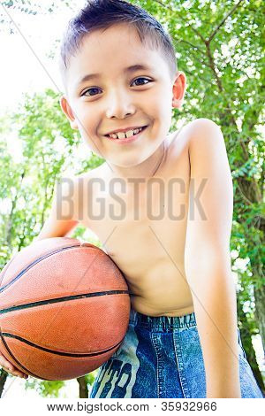 A Little Boy With Ball In His Hands