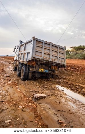 Truck Stuck. The Rear Wheels Are Muddy. Mud Road In The Rift Valley In Kenya
