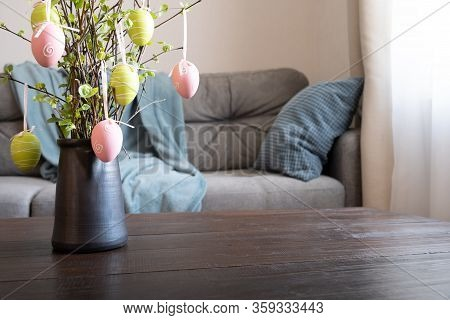 Spring Home Interior With Easter Tree Decorated Colorful Eggs. Quarantine. Self Isolation.