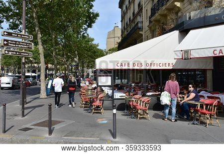 Paris, France. August 16, 2019. Parisian Cafes With Terraces And People At The Invalides Quarter Clo