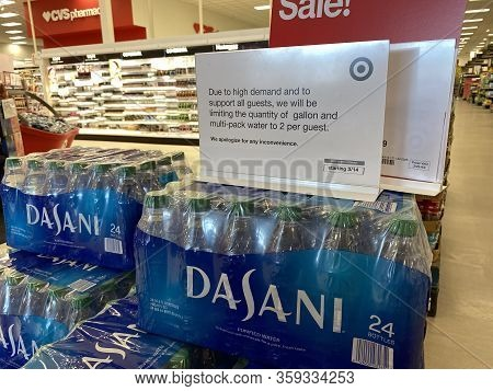 Eau Claire, Wisconsin - March 30, 2020: Sign On Top Of A Stack Of Dasani Bottled Water Reminds Custo