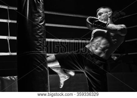 Kickboxer Hits The Bag With His Knee. Training A Professional Athlete. The Concept Of Mma, Wrestling