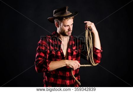 Born Roping. Wild West Rodeo. Man In Hat Black Background. Cowboy With Lasso Rope. Western. Man Chec