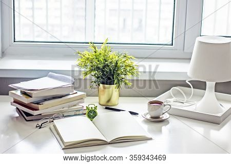 Workplace At Home.written White Table By The Window With Books, A Notebook For Text, A Flower, An Al
