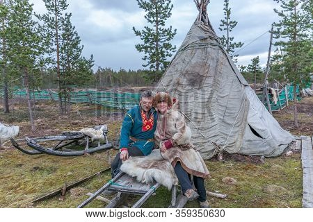Lovozero, Russia - September 25, 2016, Man And Woman, Sami In National Dress, Sami Village On The Ko