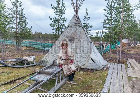 Lovozero, Russia - September 25, 2016, Female Sami In National Dress, Sami Village On The Kola Penin
