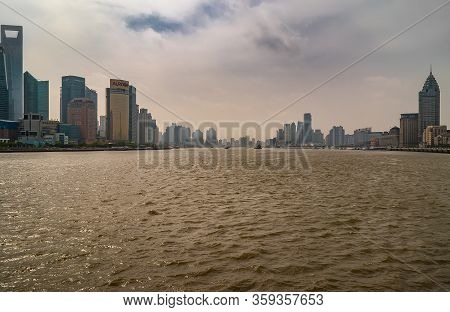 Shanghai, Pudong, Lujiazui, China - May 4, 2010: Brown Huanpu River With Skyscrapers And Other Build