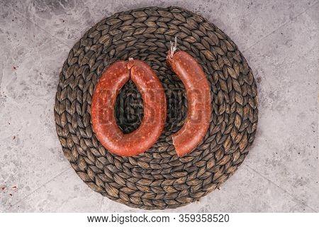Turkish Sausage Kangal Sausage. Dry Spicy Sausage On Dark Stone Background.