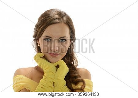 Portrait of a young beautiful girl wearing a yellow dress isolated on a white background