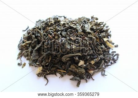 Green Leaf Tea With Dried Fruit And Flower Petals, Closeup Shot On A White Background. A Close-up Ph