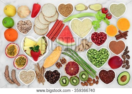 Low cholesterol healthy heart food with health foods high in fibre, antioxidants, anthocyanins, vitamins,   omega 3 & protein to support the cardiovascular system. Low GI for diabetics. Flat lay.