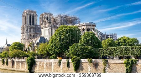 Notre Dame Cathedral in Paris after Fire. France. Seine River. Panoramic View with Blue Sky.