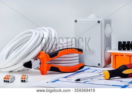 Electrical Equipment. Home Repair Concept. Different Electric Tools And Components On The Table.