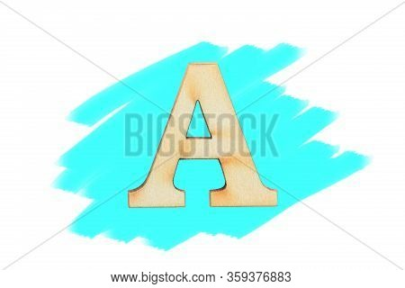 Alphabet Letter Wooden Font On Painted Color Cyan Isolated On White Background. English Flat Wood Ch