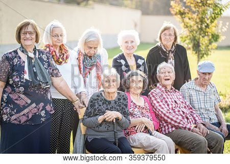 Aged people group portrait outdoors