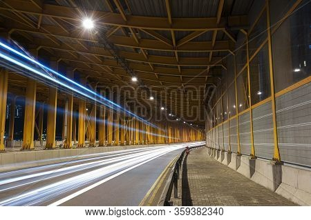 Light Trails And Head Lights Of Traffic In Tunnel. Transportation Background