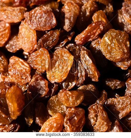 Raisins. Macro. Raisins As Background Grape Raisin Texture. Bright Sunlight Gives Sharp Shadows.