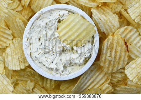A Top View Image Of Ripple Chips And Creamy Fresh Chip Dip.