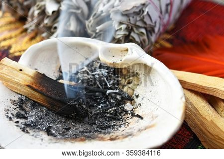 A Close Up Image Of A Burning Palo Santo Stick With Smoke Shaped Like A Heart.