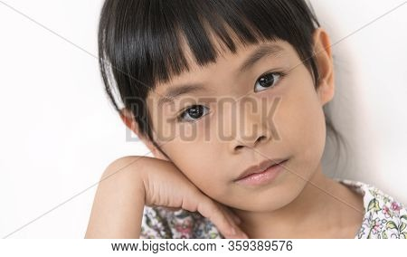 Portrait, Close Up To Face Asian Cute Child Girl, Eyes Staring Directly To Camera, Bang Hair, Black