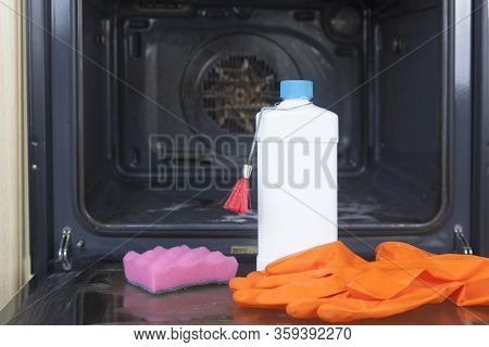 Oven Washing, Oven Cleaner, Woman Cleaning Oven In Kitchen, Closeup