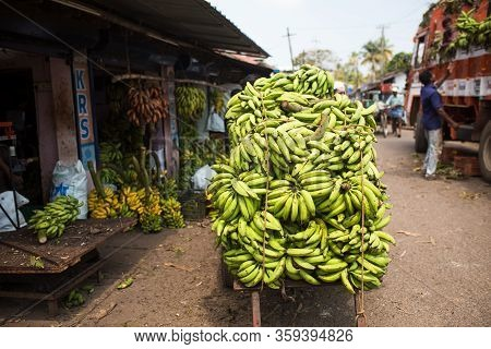 Kerala, India-january 29, 2019. Bananas Are Loaded Into The Back Of A Truck, At A Local Market. Diff