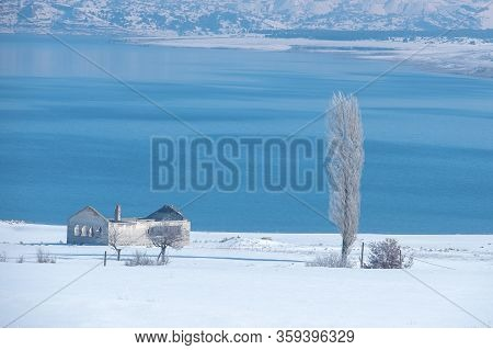Winter Snow Landcape With Lake And Village