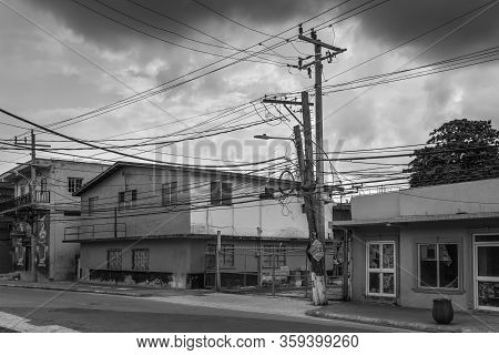 Ocho Rios, Jamaica - April 22, 2019: Street View Of Ocho Rios At Overcast Day With Offices And Shops