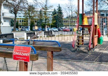 Ruzomberok, Slovakia - April 3, 2020: Closed Children Playground In Centre Of City Due Coronavirus C