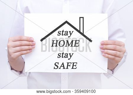 Inscription Stay Home. On A Piece Of Paper In The Hands Of A Man, A Doctor. Coronavirus, Pandemic, S