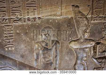 Mysterious Murals On The Walls Of The Temple Of Dendera Hathor , Near The City Of Ken. Electric Lamp