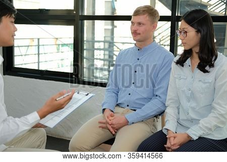 Psychiatrist Psychologist Counselor Therapist Consulting Giving Relationship Advice To Couple. Marri