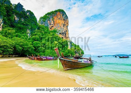 The Famous Railay Beach At Krabi, Thailand. Long Tailed Boats Are Prepared For Passengers Near Limes