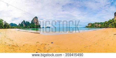 Panoramic View Of Famous Railay Beach, Krabi Thailand. Big Limestone Rock Above Pure Turquoise Sea W
