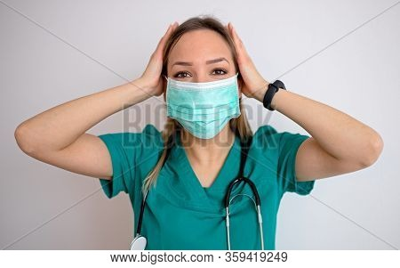 Young Nurse Feeling Extremely Shocked And Surprised, Anxious And Panicking, With A Stressed And Horr