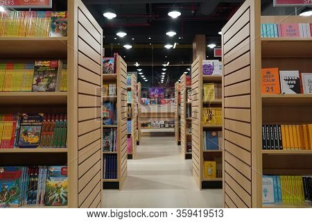 Aisle Between Shelves Of Library Books, In An Education Background Like Library. The Passage Between