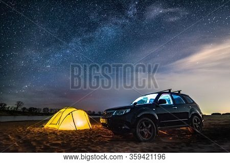 Nikolaevka, Russia - May 04, 2019: Night Camping At The River. The Milky Way In The Sky. Black Cross