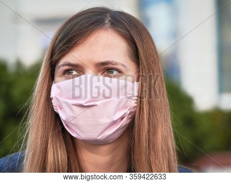 Young Woman With Hand Made Face Nose Mouth Mask Portrait, Can Be Used During Coronavirus Covid19 Out