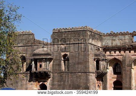 View Of Section Of Hindola Mahal Or Swinging Palace With Sloping Side Walls At Mandu In Madhya Prade
