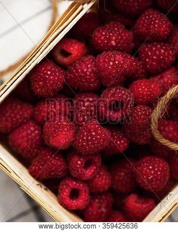 A Lot Of Ripe Raspberries In A Wicker Basket