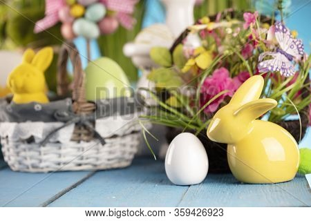 Easter Theme. Easter Decorations. Easter Eggs In Basket And Cabbage Leaf. Bouquet Of Spring Flowers.