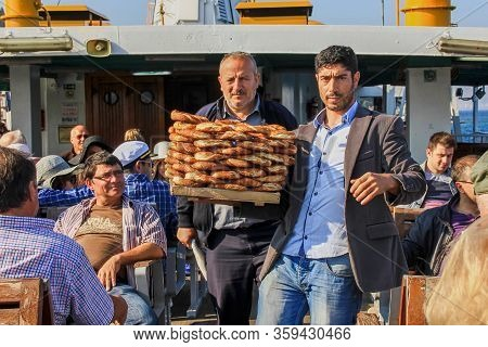 Handsome Turkish Man,bagel Vender And His Elderly Partner Selling Delicious Turkish Bagels With Sesa