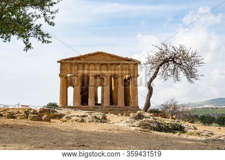 Tempio Della Concordia In Valley Of The Temples Near Agrigento, Sicily, Italy Behind Trees