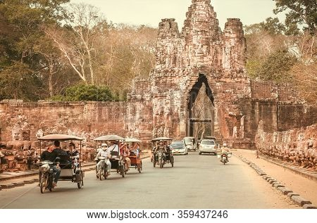 Siem Reap, Cambodia: Many Rickshaws Driving Past The Gate Of Angkor Thom, Great City Of 12th Century