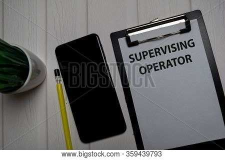 Supervising Operator Write On A Paperwork Isolated On Wooden Table.